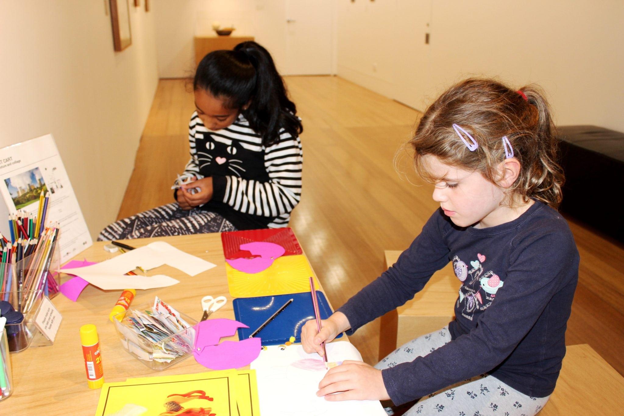 Children creating art in The Lane